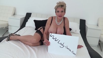 Busty mature Lady Sonia oils tits & fingers pussy