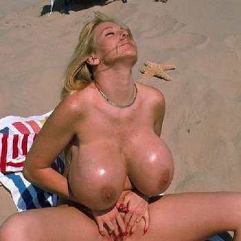 Sexy blonde Kayla Kleevage naked at the beach