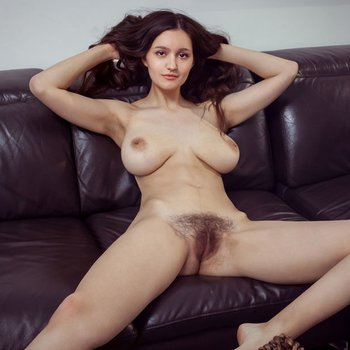 Adeline shows big lovely breasts and bushy pussy
