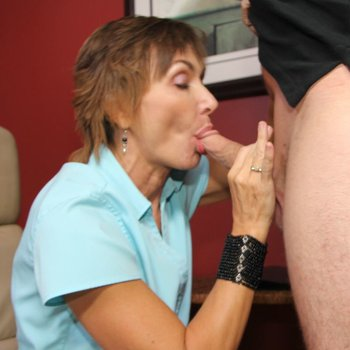 MILF Lillian Tesh blows a younger guy at an office