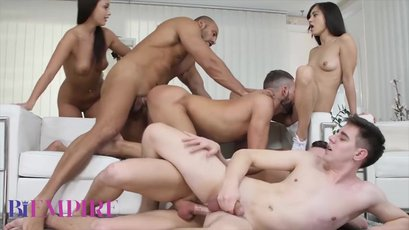Two sexy brunettes fucked in a wild bisexual orgy