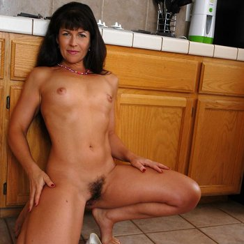 Andie naked in the kitchen having some fun