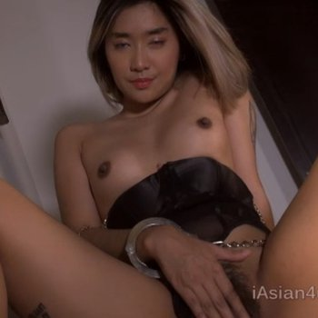 Stunning Asian chick stripping and rubbing her hairy pussy