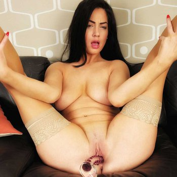 Jess rams the big glass toy deep into her pussy