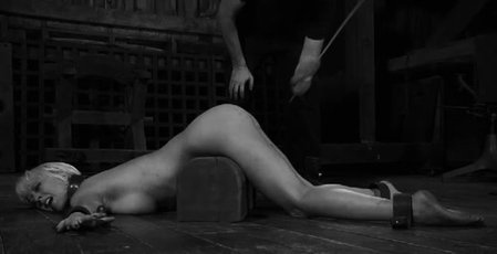 Bound blonde babe gets spanked with a whip