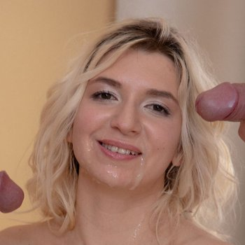 Blonde babe Cornelia Quinn gets her face covered with cum