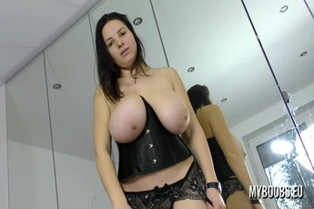 Amanda Talia showing her tits in front of a mirror