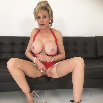 Sexy mature Lady Sonia loves showing off her big boobs