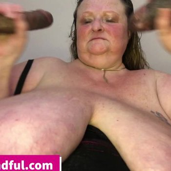 Horny mature BBW loves jerking off two cocks at the same time