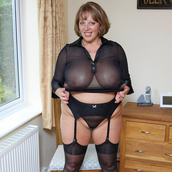 Big titted mature Curvy Claire enjoys spreading and teasing in nylons