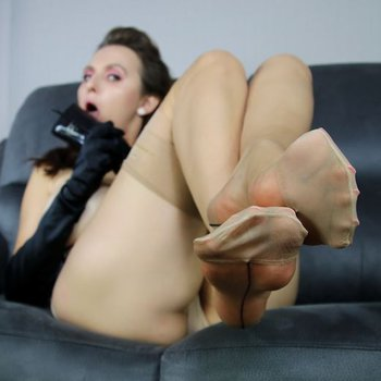 Sexy Lena on a Couch showing off her Feet