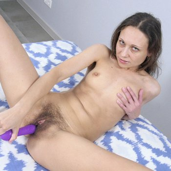 Horny MILF Cathy using a toy on her hairy pussy
