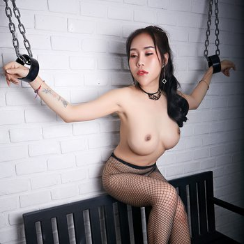 Big-titted asian hottie chained in bondage scene