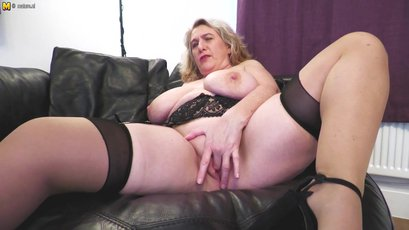 Big breasted mature finger fucking her big pussy