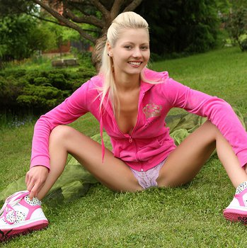 Naughty blonde babe June having fun with a toy outdoors