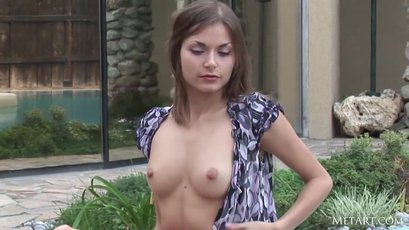 Sexy babe Eva E is having fun outdoors