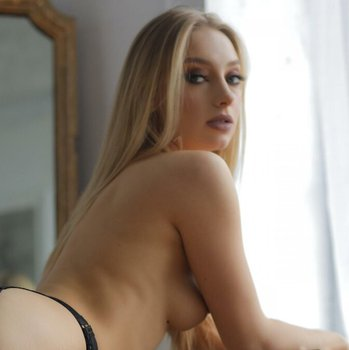 Sexy Anna Ioannova gets nude and shows smooth body