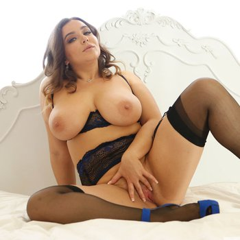 Busty Natasha Nice spreads legs in stockings