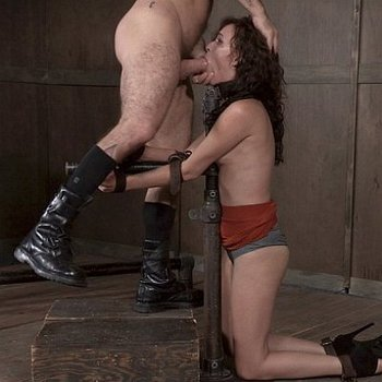 Alex More curly brunette is rope and metal bound