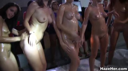 College babes get oiled up for a lesbian hazing session
