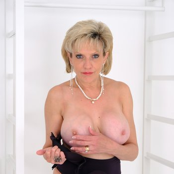 Gorgeous woman Lady Sonia demonstrates her breasts