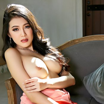 Sexy asian brunette takes off red summer dress