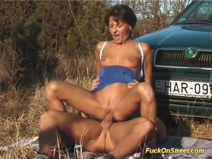 Wild bitch gets shagged on a car outdoors