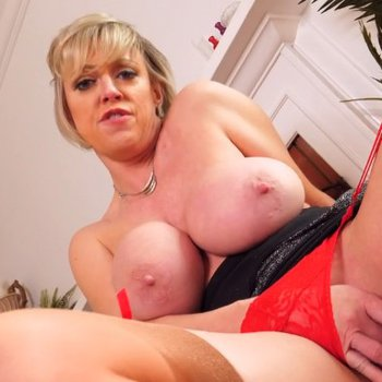 Busty Dee Williams moans while fingering herself
