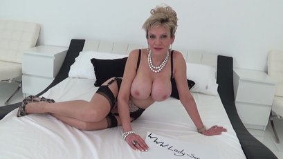 Mature nurse Lady Sonia playing with a huge dildo