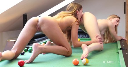 Eveline Dellai & Jenny Wild fingering and licking pussy on a pool table