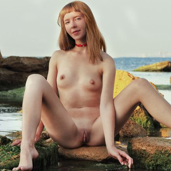 Tender babe in an erotic photoshoot by the river