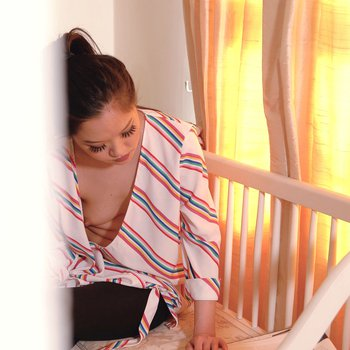 Asian chick Louisa Lu teases with her boobs through open blouse