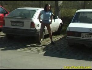 Watch this nasty chick simply peeing on street