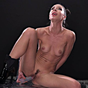 Skinny Milana Ricci drilling her pussy with a toy