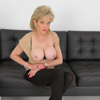 Lady Sonia showing her tits while posing