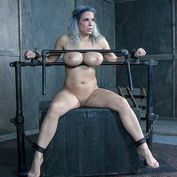 Busty submissive Alyssa Lynn trapped and spanked in the dungeon