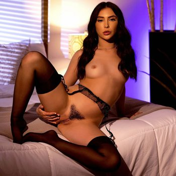 Sweet Jane Wilde showing her hairy pussy while posing