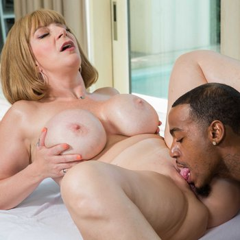 Naughty mature lady Sara Jay gets licked and dicked by her black masseur