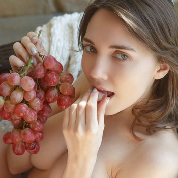 Danniela loves to taste her grapes being nude