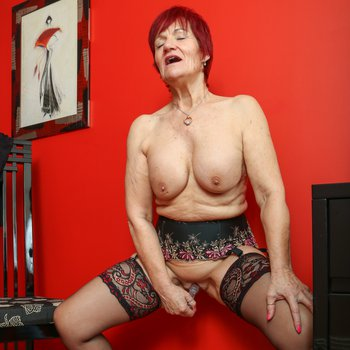 Hot redhead cougar pleases herself with a new sex toy