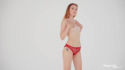 Small titted redhead babe Luna Lesun strips off her sexy red lingerie