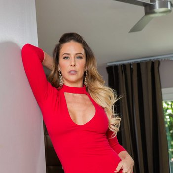 Superb cougar Cherie DeVille in sexy red dress fucks a younger dude