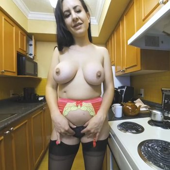 Busty babe loves posing sexy in the kitchen