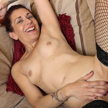 Horny housewife rubbing her cunt on the couch