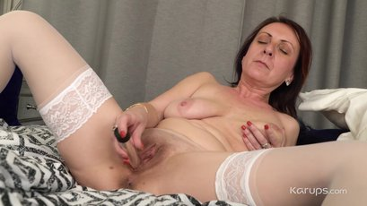 Linda G loves to play pussy with a toy