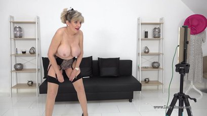 Busty mature maid Lady Sonia stripping and teasing