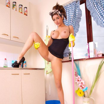 Gorgeous Model teasing while doing the Housework