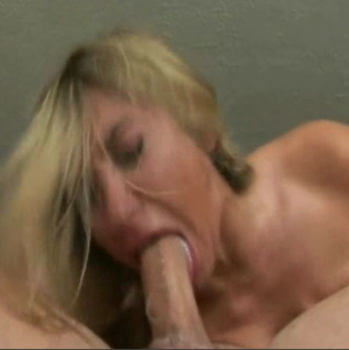 Blonde hottie gives head and gags over a hard cock.