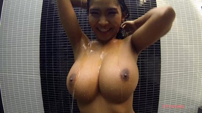 Busty chick strips naked in the shower
