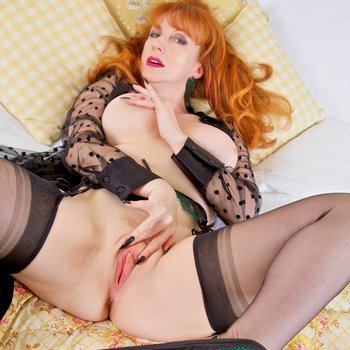 MILF Red XXX looks very lascivious in lingerie